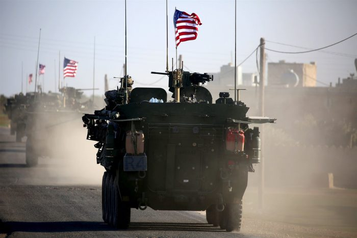 Trump says he agrees 100 percent with keeping U.S. troops in Syria
